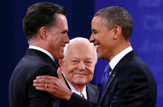 Barack Obama and Mitt Romney shake hands in Boca Raton, Florida.